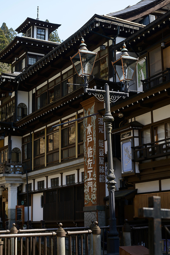 Hotel spring accomodation. Ginzan Onsen, Yamagata Prefecture, Japan, April 12, 2016. Once a sliver-mining town, Ginzan Onsen in Yamagata Prefecture is now one of Japan's best-known and most picturesque hot spring resorts. Its Taisho-period architecture and retro atmosphere is said to have been an inspiration for Hayao Miyazaki's Oscar-winning animated film, Spirited Away.