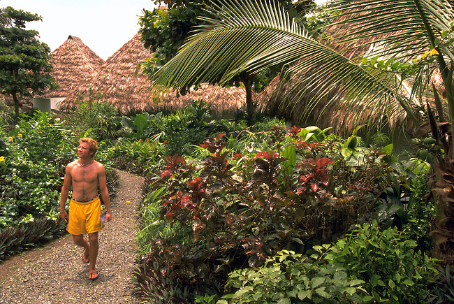 Costa Rica.  A guest walks through the grounds of Lapa Rios resort.