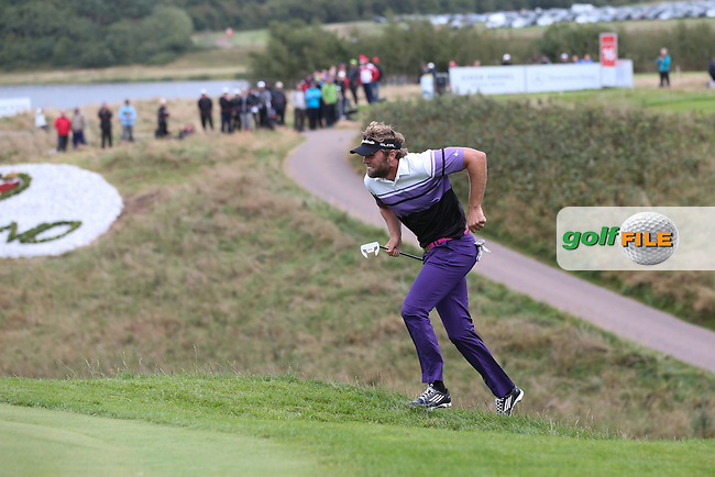 Johan Carlsson (SWE) may not appear to be a runner but the man can jump, much to the delight of the crowd on the 16th hole during the Final Round of Made in Denmark 2014, from the Himmerland Golf & Spa Resort, Aalborg, Denmark. Picture:  David Lloyd / www.golffile.ie