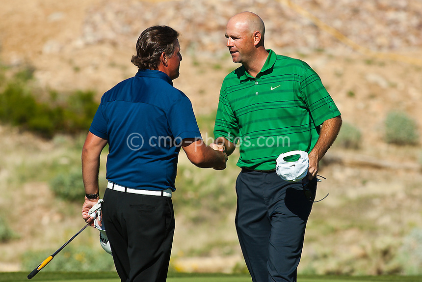 Feb 27, 2009; Marana, AZ, USA; Stewart Cink (USA) and Phil Mickelson (USA) shake hands on the 18th hole after Cink defeated 1 up in the third round of the World Golf Championships-Accenture Match Play Championship at the Ritz-Carlton Golf Club, Dove Mountain.