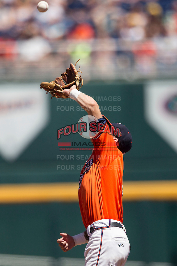Virginia Cavaliers second baseman Ernie Clement (4) catches a pop fly against the Florida Gators in Game 11 of the NCAA College World Series on June 19, 2015 at TD Ameritrade Park in Omaha, Nebraska. The Gators defeated Virginia 10-5. (Andrew Woolley/Four Seam Images)