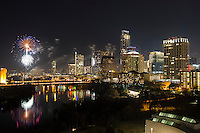 Aerial view as Austin welcomes the New Year with colorful fireworks display celebration over the downtown Austin cityscape and Lady Bird Lake.