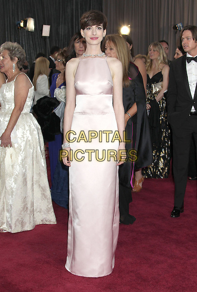 Anne Hathaway (wearing Prada).85th Annual Academy Awards held at the Dolby Theatre at Hollywood & Highland Center, Hollywood, California, USA..February 24th, 2013.oscars full length pink sleeveless silk satin dress .CAP/ADM/RE.©Russ Elliot/AdMedia/Capital Pictures.