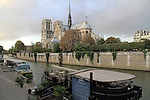 Restaurant and barge at Notre Dame Cathedral along the Seine River, Paris, France.