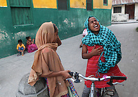 Young girls are photographed in Stone Town in Zanzibar, Tanzania. Julia