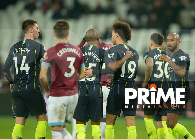 Leroy Sané of Manchester City celebrates scoring with his team mates during the Premier League match between West Ham United and Manchester City at the Olympic Park, London, England on 24 November 2018. Photo by Vince Mignott / PRiME Media Images.