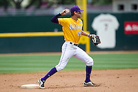 LSU Tigers second baseman JaCoby Jones (23) turns a double play against the Texas A&M Aggies in the NCAA Southeastern Conference baseball game on May 11, 2013 at Blue Bell Park in College Station, Texas. LSU defeated Texas A&M 2-1 in extra innings to capture the SEC West Championship. (Andrew Woolley/Four Seam Images).
