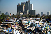 An overview of Dhobighat, the open air Laundromat in India's financial capital, Mumbai, India. The laundry comes from different sections of the society - from hospital to hospitality to garment factories and normal households.