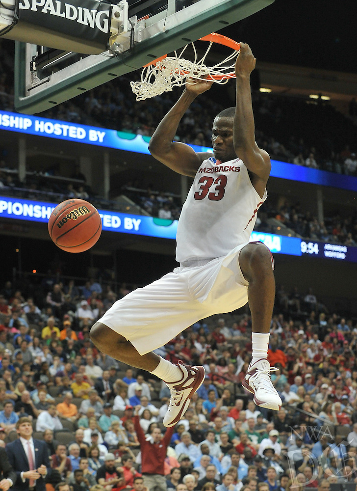 NWA Democrat-Gazette/Michael Woods --03/19/2015--w@NWAMICHAELW... University of Arkansas forward Moses Kingsley goes up for a dunk on a fast break during the first half of Thursday nights game against the Wofford Terriers in the 2015 NCAA basketball tournament at Jacksonville Veterans Memorial Arena in Jacksonville, Florida.