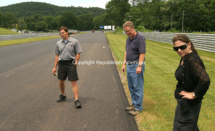 LAKEVILLE, CT- 02 JULY 2008 --070208JS07-Scott Mayo, left, Operations Manager at Lime Rock Park in Lakeville, looks over a portion of the track with Joe Sauer Director of Operations at the track and Cheif Marketing Officer Maria Jannace on Wednesday. The park is in the final stages of their rennovation project. <br /> Jim Shannon / Republican-American