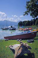 Pleasure craft on Forggensee lake close to Neuschwansein castle. Bavaria, South Germany.