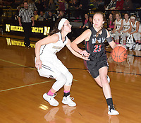 RICK PECK/SPECIAL TO MCDONALD COUNTY PRESS<br /> McDonald County's Kristin Penn drives past Neosho's Mary Dunbar during the Lady Mustangs' 46-42 loss on Jan. 25 at Neosho High School.