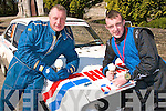 1810-1812.---------.Hand Brake Turn.---------------.Father and son team,Charley and Johnny Hickey from Killarney with their ford MK2 escort enjoy the sunshine and icecream at the 30th running of the Rally of the Lakes in killarney last weekend.