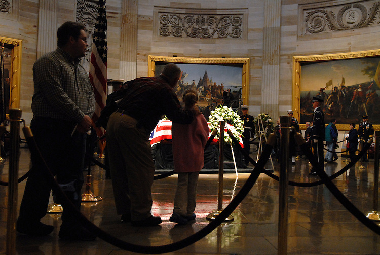 James Finney of Bowie, Md., and his granddaughter Sara Shelton, 8, view the coffin of former president Gerald Ford, as he lay in state in the Capitol Rotunda, New Year's Day.