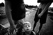 Wroclaw 13.07.2006 Poland<br /> The worst and the most dangerous district in Wroclaw ( Poland ) , called by people &quot;The Bermuda Triangle&quot;. There are walls bearing an inscription &quot;Who will enter here, will not exit alive&quot; Many families there are pathological and live in extreme poverty. Children have no place for any games so they loaf around on this wasted district and disseminate a juvenile delinquency. Many of them become sexually active though they are only 10-12 years old<br /> (Photo by Adam Lach / Napo Images)<br /> <br /> Najbardziej nabezpieczna dzielnica we Wroclawiu zwana przez ludzi Trojkatem Bermudzkim. Sa tam sciany opatrzone napisem &quot; Kto tu wejdzie, nigdy nie wyjdzie stad zywy&quot; Mieszka tam wiele rodzin patologicznych i zyja w wielkiej nedzy. Dzieci wlocza sie po ulicach nie majac miejsc na zabawe i szerza przestepczosc wsrod nieletnich. Wiele z dzieci uprawia seks choc maja zaledwie 10-12 lat<br /> (Fot Adam Lach / Napo Images)