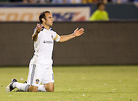 LA Galaxy forward Landon Donovan (10) on his knees looking for a call from the ref. The LA Galaxy and the San Jose Earthquakes played to a 2-2 draw at Home Depot Center stadium in Carson, California on Thursday July 22, 2010.