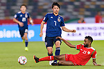 Shibasaki Gaku of Japan (L) is tackled by Harib Al Saadi of Oman (R) during the AFC Asian Cup UAE 2019 Group F match between Oman (OMA) and Japan (JPN) at Zayed Sports City Stadium on 13 January 2019 in Abu Dhabi, United Arab Emirates. Photo by Marcio Rodrigo Machado / Power Sport Images