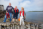 Boatmen Paul O'Connell & Donie O'Sullivan cam to the aid of swimmers caught up in a Bloom of Jellyfish close to the shore on Valentia Island on Monday pictured here with one of the swimmers Eileen Remedios, who also owns a holiday home on the Island.
