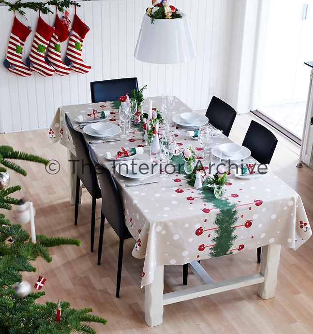 The spacious kitchen/diner, with a table laid for Christmas, viewed from the staircase