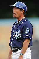 Asheville Tourists hitting coach Lenn Sakata #14 coaches first base during a game against the Rome Braves at McCormick Field on June 23, 2011 in Asheville, North Carolina.  The Tourists won the game 10-4.  (Tony Farlow/Four Seam Images)