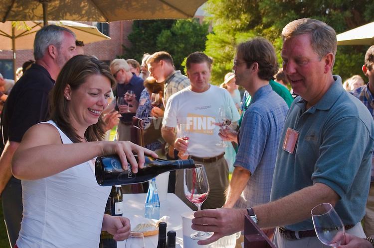 Winemaker Luisa Ponzi pouring Ponzi Vineyards vintage Pinot Noir for tasting at International Pinot Noir Celebration; McMinnville, Willamette Valley, Oregon.