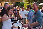 Winemaker Luisa Ponzi pouring Ponzi Vineyards vintage Pinot Noir for tasting at International Pinot Noir Celebration; McMinnville, Willamette Valley, Oregon.