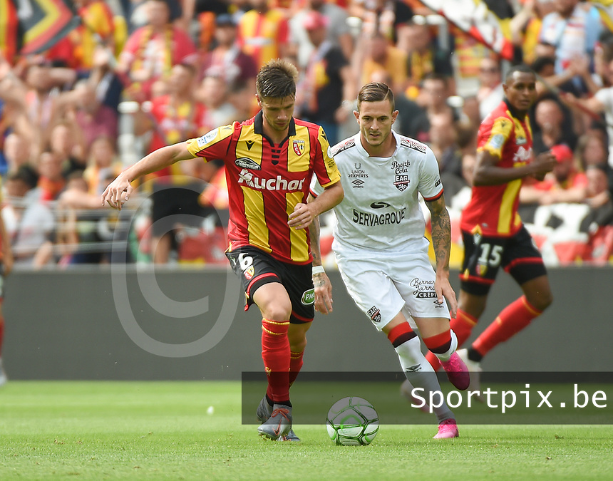 20190803 - LENS , FRANCE : Lens' Manuel Perez (L) and Guingamp's Nolan Roux (R) pictured during the soccer match between Racing Club de LENS and En Avant Guingamp , on the second matchday in the French Dominos pizza Ligue 2 at the Stade Bollaert Delelis stadium , Lens . Saturday 3 th August 2019 . PHOTO DIRK VUYLSTEKE | SPORTPIX.BE