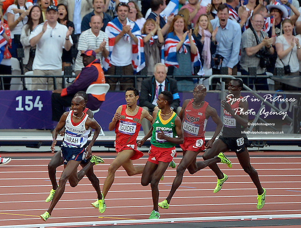 Mo Farah (GBR, Great Britain) leading at the last bend. Athletics - PHOTO: Mandatory by-line: Garry Bowden/SIP/Pinnacle - Photo Agency UK Tel: +44(0)1363 881025 - Mobile:0797 1270 681 - VAT Reg No: 768 6958 48 - 11/08/2012 - 2012 Olympics - Olympic Stadium, Olympic Park, London, England.