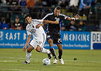 Christian Gomez (10) and Jason Hernandez (21) battle for the ball. The San Jose Earthquakes tied DC United 2-2 at Buck Shaw Stadium in Santa Clara, California on July 25, 2009.