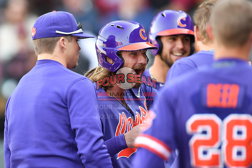 Designated hitter Reed Rohlman (26) of the Clemson Tigers celebrates after scoring a run in the Reedy River Rivalry game against the South Carolina Gamecocks  on Saturday, March 4, 2017, at Fluor Field at the West End in Greenville, South Carolina. Clemson won, 8-7. (Tom Priddy/Four Seam Images)