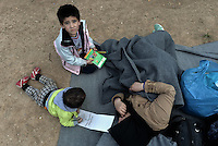 Pictured: Young children with colouring pens rest on the ground Friday 26 February 2016<br /> Re: Hundreds of refugees have temporarily camped at Victoria Square in central Athens, Greece.