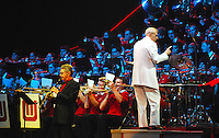 Professor Les Thimmig plays a clarinet tribute to Benny Goodman along with the UW Marching Band on Thursday at the Kohl Center
