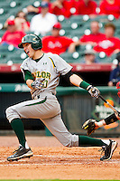 Jake Miller #20 of the Baylor Bears follows through on his swing against the Houston Cougars at Minute Maid Park on March 4, 2011 in Houston, Texas.  Photo by Brian Westerholt / Four Seam Images