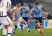 Calcio, Serie A: Lazio vs Juventus. Roma, stadio Olimpico, 4 dicembre 2015.<br /> Lazio&rsquo;s Lucas Biglia, right, is chased by Juventus&rsquo; Stefano Sturaro during the Italian Serie A football match between Lazio and Juventus at Rome's Olympic stadium, 4 December 2015.<br /> UPDATE IMAGES PRESS/Riccardo De Luca