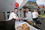 Redrow Homes Meet The Neighbours event at Parc Heol Gerrig, Merthyr Tydfil..Mike Edwards handing out the burgers to local resident Jamie Awford..25.05.13.©Steve Pope