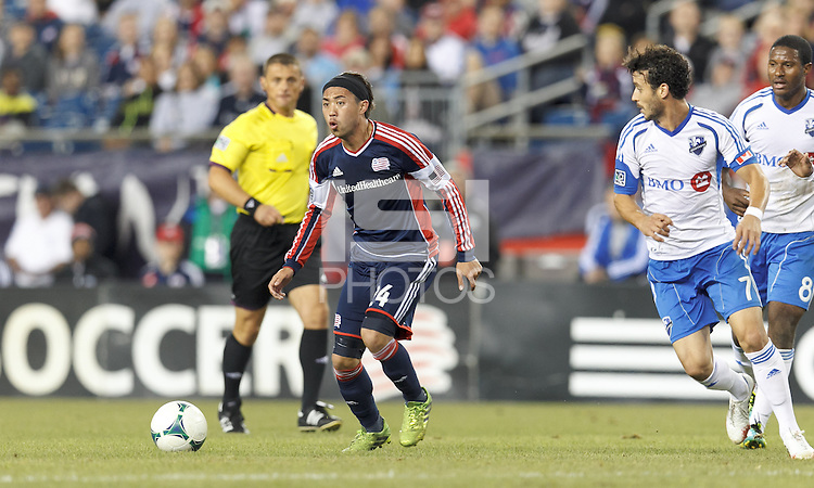 New England Revolution midfielder Lee Nguyen (24) looks to pass. In a Major League Soccer (MLS) match, Montreal Impact (white/blue) defeated the New England Revolution (dark blue), 4-2, at Gillette Stadium on September 8, 2013.
