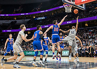 WASHINGTON, DC - DECEMBER 28: Terrell Allen #12 of Georgetown shoots over Ben Lubarsky #30 of American. during a game between American University and Georgetown University at Capital One Arena on December 28, 2019 in Washington, DC.