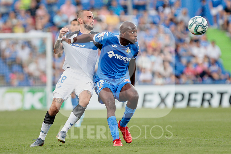 Allan-Romeo Nyom of Getafe CF and Aleix Vidal of Deportivo Alaves during La Liga match between Getafe CF and Deportivo Alaves at Colisseum Alfonso Perez in Getafe, Spain. August 31, 2019. (ALTERPHOTOS/A. Perez Meca)