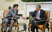 United States President Barack Obama shakes hands with the Amir of Qatar, His Highness Sheikh Tamim bin Hamad al Thani, in the Oval Office of the White House February 24, 2015 in Washington, DC.<br /> Credit: Olivier Douliery / Pool via CNP