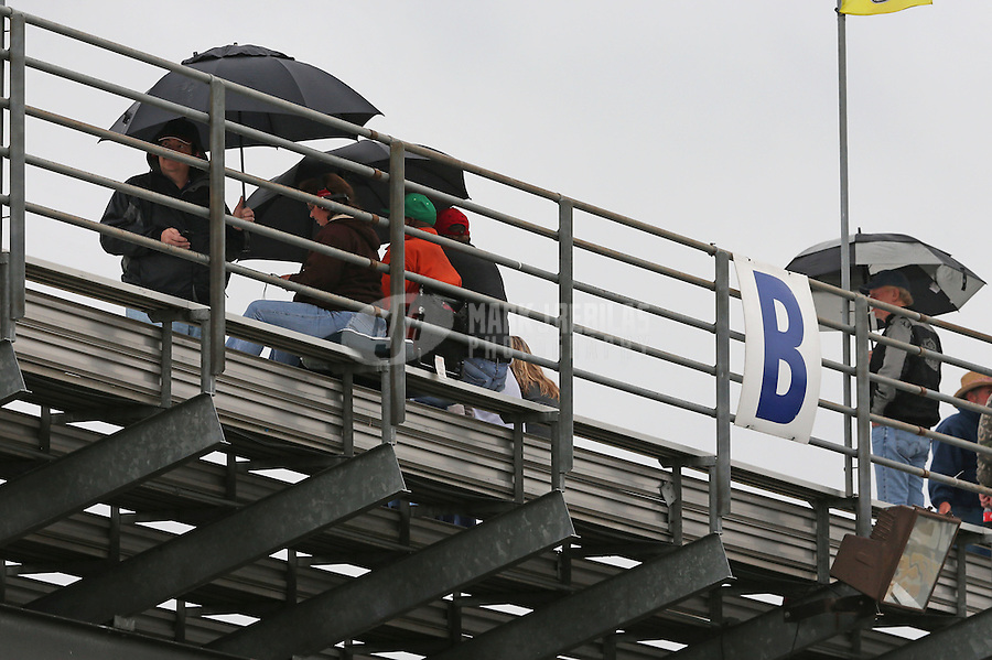 May 3, 2013; Commerce, GA, USA: NHRA fans in the grandstands beneath umbrellas during a ran delay to qualifying for the Southern Nationals at Atlanta Dragway. Mandatory Credit: Mark J. Rebilas-