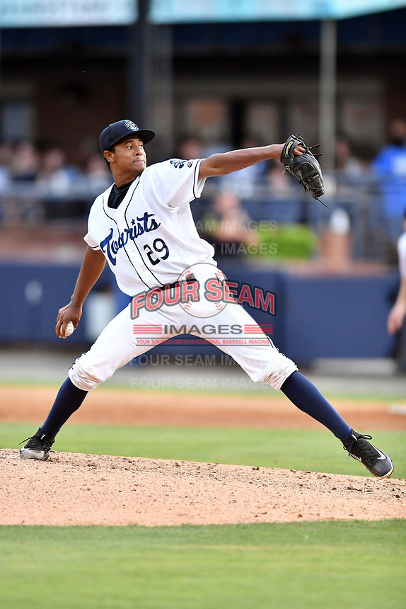 Asheville Tourists starting pitcher Erick Julio (29) delivers a pitch during a game against the Charleston RiverDogs at McCormick Field on July 5, 2017 in Asheville, North Carolina. The RiverDogs defeated the Tourists 10-9. (Tony Farlow/Four Seam Images)