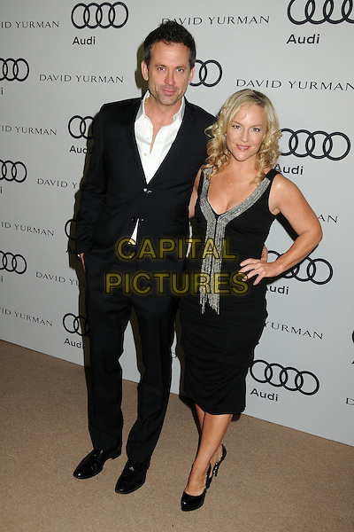 guest & Rachael Harris.Audi and David Yurman Emmy Week 2011 Kick Off Party held at Cecconi's, West Hollywood, California, USA..September 11th, 2011.full length suit white shirt dress hand on hip.CAP/ADM/BP.©Byron Purvis/AdMedia/Capital Pictures.