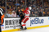 September 26, 2018: Detroit Red Wings forward Michael Rasmussen (27) checks Boston Bruins defenseman Urho Vaakanainen (58) during the NHL pre-season game between the Detroit Red Wings and the Boston Bruins held at TD Garden, in Boston, Mass. Detroit defeats Boston 3-2 in overtime. Eric Canha/CSM