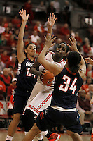 Ohio State Buckeyes center Darryce Moore (22) drives through Gonzaga Bulldogs guard Keani Albanez (24) and Gonzaga Bulldogs guard Jazmine Redmon (34) in the second half at Value City Arena in Columbus Dec. 8, 2013.(Dispatch photo by Eric Albrecht)