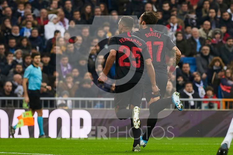 Fernando Reges (L) and Gudelj (R) of Sevilla FC celebrate goal during La Liga match between Real Madrid and Sevilla FC at Santiago Bernabeu Stadium in Madrid, Spain. January 18, 2020. (ALTERPHOTOS/A. Perez Meca)