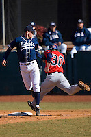 First baseman Brett Huffman #41 of the Catawba Indians puts the tag on Zack Piper #30 of the Shippensburg Red Raiders February 14, 2010 in Salisbury, North Carolina.  Photo by Brian Westerholt / Four Seam Images