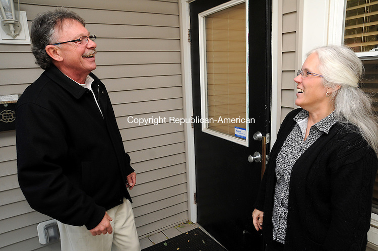 TORTINGTON, CT, 25 OCT 13- 102513AJ01- Democratic mayoral candidate George Craig meets with Kari Kotila at Performance Plubing & Heating on Migeon Avenue in Torrington Friday while campaigning.  Alec Johnson/ Republican-American