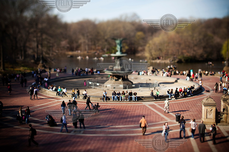 People gather at Bethesda fountain in Central Park, New York City.