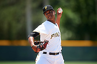 GCL Pirates relief pitcher Oddy Nunez (12) during a game against the GCL Braves on August 10, 2016 at Pirate City in Bradenton, Florida.  GCL Braves defeated the GCL Pirates 5-1.  (Mike Janes/Four Seam Images)