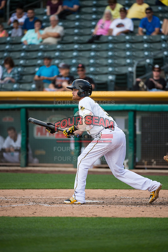 Ryan Jackson (5) of the Salt Lake Bees squares to bunt against the Albuquerque Isotopes in Pacific Coast League action at Smith's Ballpark on June 8, 2015 in Salt Lake City, Utah.  The Bees defeated the Isotopes 10-7 in game one of a double-header.(Stephen Smith/Four Seam Images)
